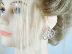 Cercei eleganti bucle argintii
